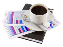 Coffee, Standing On Organizer, And Diagrams. Royalty Free Stock Images
