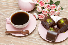 Coffee and star cookies with pink flowers Stock Images