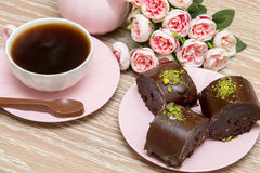 Coffee and star cookies with pink flowers Royalty Free Stock Photo