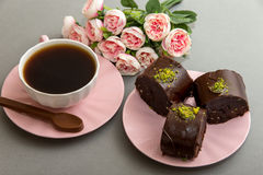 Coffee and star cookies with pink flowers Stock Photography