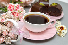 Coffee and star cookies with pink flowers Stock Photos