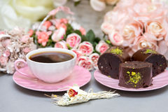 Coffee and star cookies with pink flowers Royalty Free Stock Photography