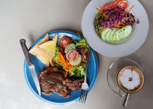 Coffee, steaks and salads Royalty Free Stock Images