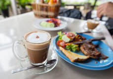 Coffee and steaks on the table. Royalty Free Stock Images