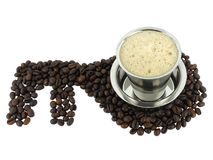Coffee. In a steel cup and  beans Royalty Free Stock Photography