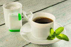 Coffee with stevia sweetener. Cup of coffee with stevia sweetener tabs or in powder form Stock Photos