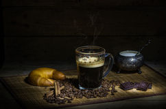 Coffee. Still life with coffee, croissant, chocolate, cinnamon and coffee beans Royalty Free Stock Photography