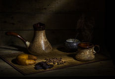 Coffee. Still life with coffee, croissant, chocolate, cinnamon and coffee beans Stock Image