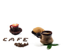 Coffee. Still life with cup of coffee, a Turk, a croissant and coffee beans Royalty Free Stock Photography