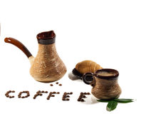 Coffee. Still life with cup of coffee, a Turk, a croissant and coffee beans Royalty Free Stock Image