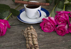 Coffee still life, pink roses and cookies Stock Photo
