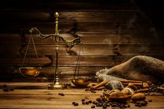 Coffee still-life. Coffee theme with brass scales still-life on wooden table stock photo