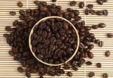 Coffee straw. Cup full of coffee beans on straw stock photo