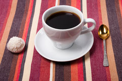 A coffee on a striped tablecloth Royalty Free Stock Photography