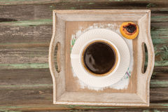 Coffee, a subject food and drinks. A cup of coffee and cookies on a wooden platter Royalty Free Stock Image