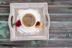 Coffee, a subject food and drinks. Cup of coffee on a wood background, cake, roses Royalty Free Stock Photography
