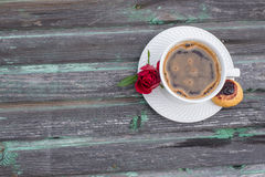 Coffee, a subject food and drinks. Cup of coffee on a wood background, cake, roses Royalty Free Stock Photos