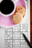 Coffee and sudoku Royalty Free Stock Photos