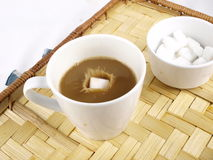 Coffee with Sugar. Sugar cube falling into the coffee Stock Photos