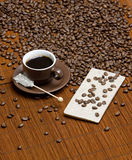 Coffee with sugar. Still life of coffee with sugar and coffee chocolate Royalty Free Stock Photography