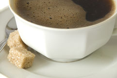 Coffee and sugar. Close up on a perfect freshly made coffee Royalty Free Stock Image