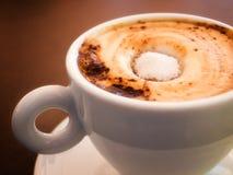 Coffee with sugar. Closeup image of espresso coffee with white sugar Stock Photos