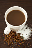 Coffee With Sugar. Coffee in a white mug with sugar Stock Photography