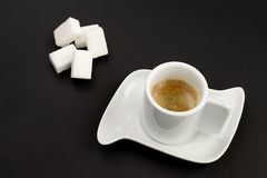 Coffee and sugar on black. Cup of espresso coffee on black background Stock Photo