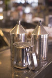 Coffee sugar milk dispensers in cafe bar Stock Photo