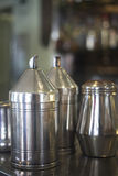 Coffee sugar milk dispensers in cafe bar Royalty Free Stock Photo