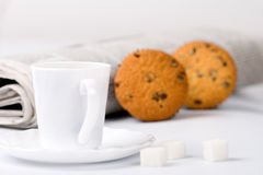 Coffee, sugar, muffins and newspapers Royalty Free Stock Images