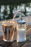 Coffee and sugar. Nes coffee and white sugar with view on water Royalty Free Stock Photos
