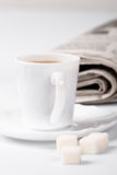 Coffee, sugar and newspapers Stock Image