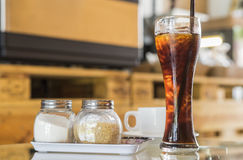 Coffee. And sugar set on the table : Focus on ice Stock Images