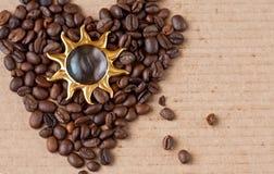 Coffee and the sun. Coffee as a heart and golden sun Stock Photos