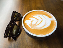 Coffee with sunglass. On wood background Royalty Free Stock Photos