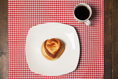 Coffee and sweet cupcake on checkered napkin Stock Photos