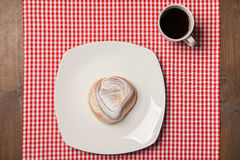 Coffee and sweet cupcake on checkered napkin Stock Photography