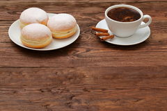 Coffee and sweet donuts. Sweet donut with a cup of coffee for breakfast topped with a hint of the smell of cinnamon. Love the sweet moments together in Stock Images