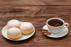 Coffee and sweet donuts. Sweet donut with a cup of coffee for breakfast topped with a hint of the smell of cinnamon. Love the sweet moments together in Stock Photos
