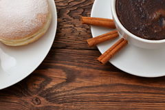 Coffee and sweet donuts. Sweet donut with a cup of coffee for breakfast topped with a hint of the smell of cinnamon. Love the sweet moments together in Stock Photo