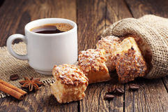 Coffee and sweet puff cookies with nuts Royalty Free Stock Image