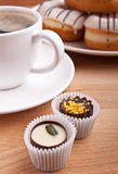 Coffee, sweets and donuts Royalty Free Stock Photos