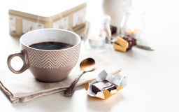 Coffee, sweets and flowers Stock Image