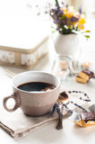 Coffee, sweets and flowers Stock Photography