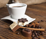 Coffee , sweets and spices on an old wooden table Stock Image