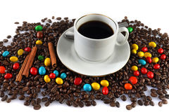 Coffee and sweets. Still life with a cup of coffee, coffee grains and candy allsorts Stock Photography