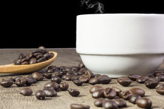 Coffee and sweets to tasty on a wooden floor Stock Photos