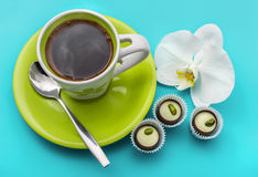 Coffee, sweets and white orchid on blue. Stock Photography