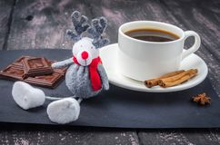 Coffee and sweets on a wooden table royalty free stock image